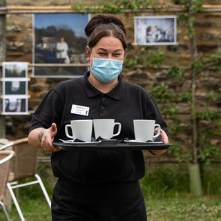 staff serving drinks outside wearing face mask