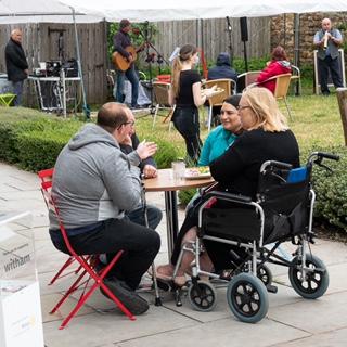 customers enjoying garden cafe